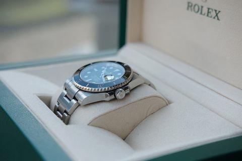 Watch accessory, Turquoise, Fashion accessory, Watch, Jewellery, Analog watch, Brand, Strap, Metal, Silver,