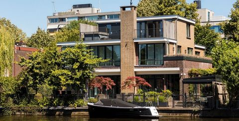 Waterway, Property, Home, House, Canal, Architecture, Residential area, Real estate, Building, Water transportation,