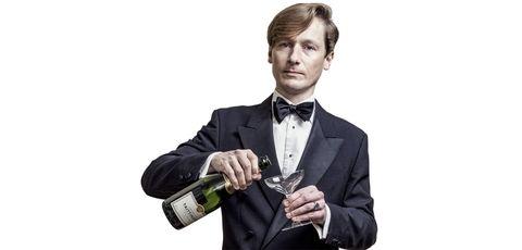 Suit, Formal wear, White-collar worker, Tuxedo, Alcohol, Tie, Drinkware, Businessperson, Wine bottle, Drink,