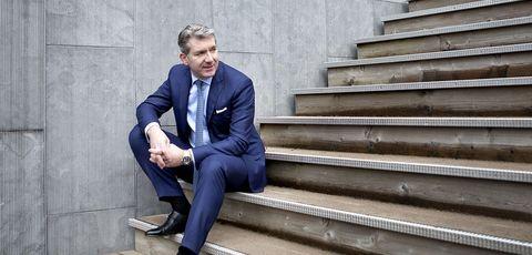 Suit, Blue, White-collar worker, Sitting, Standing, Businessperson, Blazer, Footwear, Formal wear, Shoe,