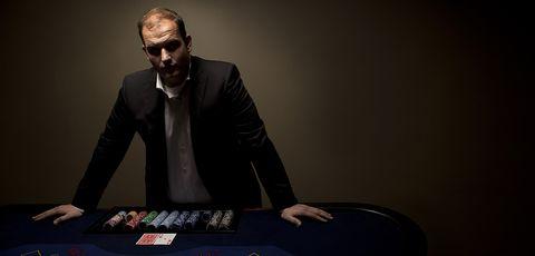 Games, Gambling, Poker, Table, Electronic instrument, Eyewear, Recreation, Sitting, Suit, Facial hair,
