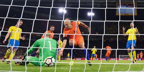 Player, Sport venue, Sports equipment, Net, Sports, Team sport, Goalkeeper, Stadium, Goal, Ball game,
