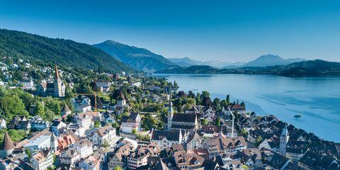 Town, Sky, Mountain, Aerial photography, Hill station, Tourism, Human settlement, Mountain range, Mountain village, City,
