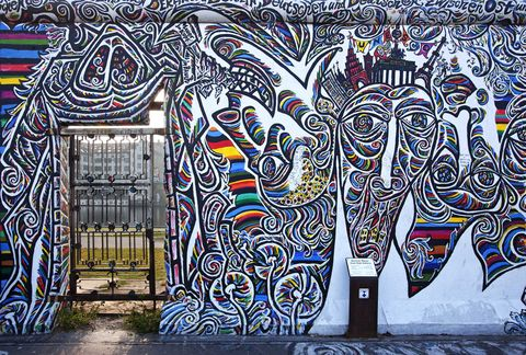 Detail of mural at East Side Gallery on Muhlenstrasse, Friedrichshain District.