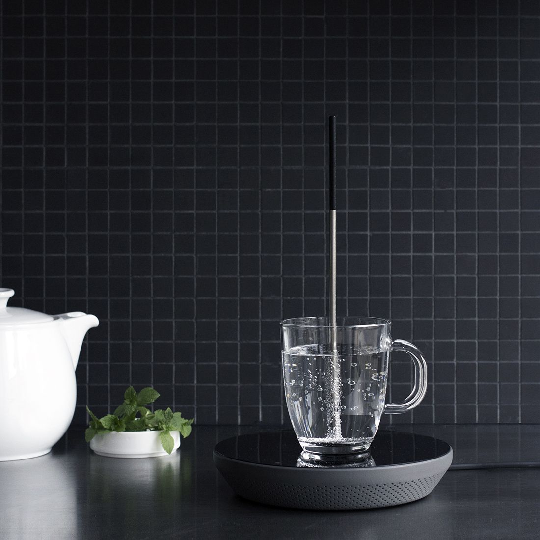 "<div>With <a href=""http://miito.de/"">Miito</a>, there's no need to heat up excess water: Just immerse the rod in water, using whatever cup you have available, and place it on the induction base. Hot liquid! The rod can also be used to reheat your coffee or soup. </div>"