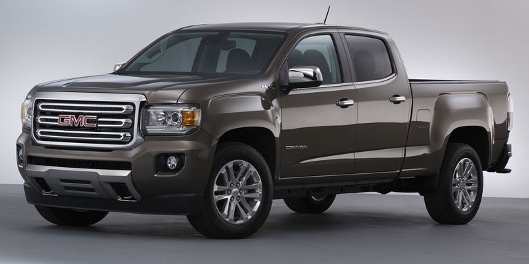truck quarter canyon crew unveils gm cab slt work photos a for reveal small big three front gmc the