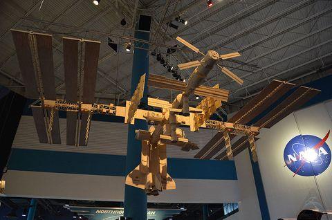 Ceiling, Space, Space station, Symbol, Cross, Religious item, Aerospace engineering, Satellite, Artifact, Science,