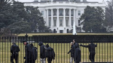 Standing, Uniform, Security, Official residence, Law enforcement, Official, Fence, Mansion, Courthouse, Headquarters,