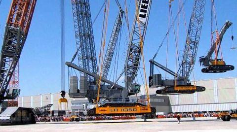 Infrastructure, Line, Crane, Landmark, Engineering, Machine, Asphalt, Composite material, Iron, Steel,