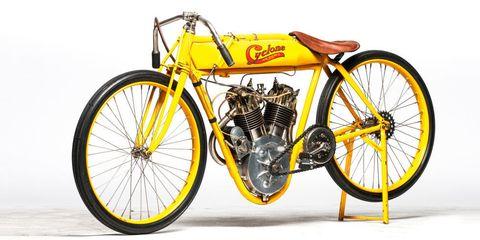 Motorcycle, Motor vehicle, Wheel, Mode of transport, Yellow, Spoke, Automotive tire, Transport, Rim, Fender,