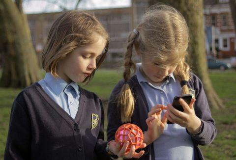 Child, Blond, School uniform, Football, Fruit, Toy, Sweater, Mobile phone, Curious,