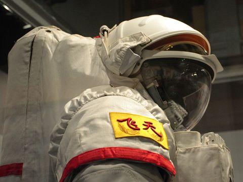 Astronaut, Personal protective equipment, Emergency service, Space, Carmine, Uniform, Headgear, Service, Workwear, Helmet,