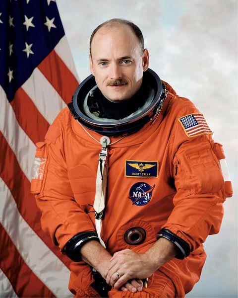 Sleeve, Hand, Uniform, Watch, Glove, Flag, Flag of the united states, Buzz cut, Astronaut, Bracelet,