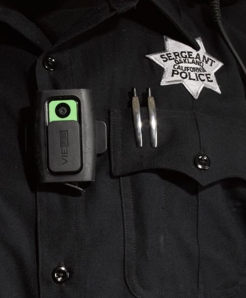 "In 2010 the Oakland, CA, Police Department became the first large police force in the country to wear body cameras that record everything the officers see, say, and do. Chief Sean Whent describes the transition:  ""There was some skepticism at first, but the officers have been won over. They really see the value in it. The cameras show that they are hardworking and do the right thing consistently. There are other factors to attribute this to as well, but over the last two years we're looking at a more than 50 percent reduction in complaints. Those complaints that do come in, we're able to resolve them a lot faster. And while occasionally we'll catch somebody doing something they shouldn't be, the video evidence used in complaints overwhelmingly supports the police—more than 90 percent support the officer.  ""It used to be that you turn on the camera when you get out of the car to walk up to the car you've pulled over. We realized that works great for your routine car stop, but it does not work if it becomes a pursuit. So now, before you even attempt to make a car stop, you turn on the camera.  ""The cameras are not perfect. They show a frontal view from the direction the officer's chest is facing, but that doesn't necessarily mean the officer is looking in that direction or that he isn't talking to somebody at his side. Also, nighttime video is not great. The technology may improve, but you don't want better vision than the officer is capable of seeing either, because then there's no way to know what the officer actually saw.  ""One of our major goals as a police department over the last few years has been to work on trust within the community. This is the way of the future. Law enforcement going forward has to be dedicated to some level of transparency. The public demands that, and rightfully so."""