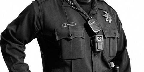 Human, Sleeve, Police, Collar, Standing, Joint, Uniform, Personal protective equipment, Security, Law enforcement,