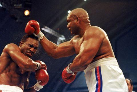Boxing glove, Nose, Sport venue, Boxing, Boxing equipment, Professional boxer, Sports uniform, Professional boxing, Combat sport, Competition event,
