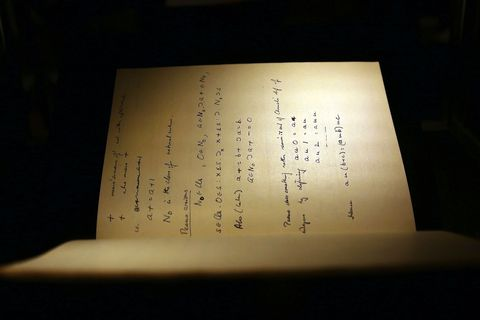 """NEW YORK, NY - APRIL 09:  The 1942 56-page notebook belonging to codebreaker Alan Turing is displayed at Bonham's auction house on April 9, 2015 in New York City. The notebook, along with a working Enigma cipher machine that the math genius used, are to be auctioned on in New York on Monday. the notebook alone is  expected to go for $1 million. Turing's life and work were recently brought to life in the 2014 blockbuster """"The Imitation Game"""", which drew eight Oscar nominations.  (Photo by Spencer Platt/Getty Images)"""