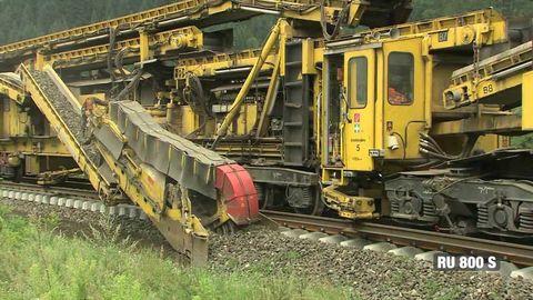 Train track ballast cleaner