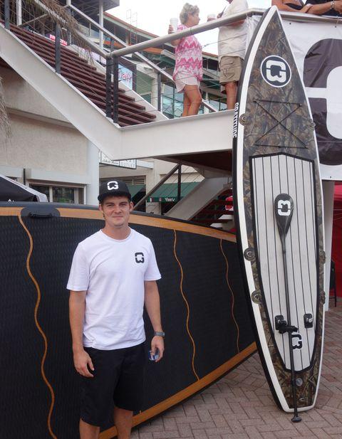 Surfing Equipment, Surfboard, Standing, Stairs, Surface water sports, Boardsport, Sunglasses, Water sport, Bermuda shorts, Surfing,