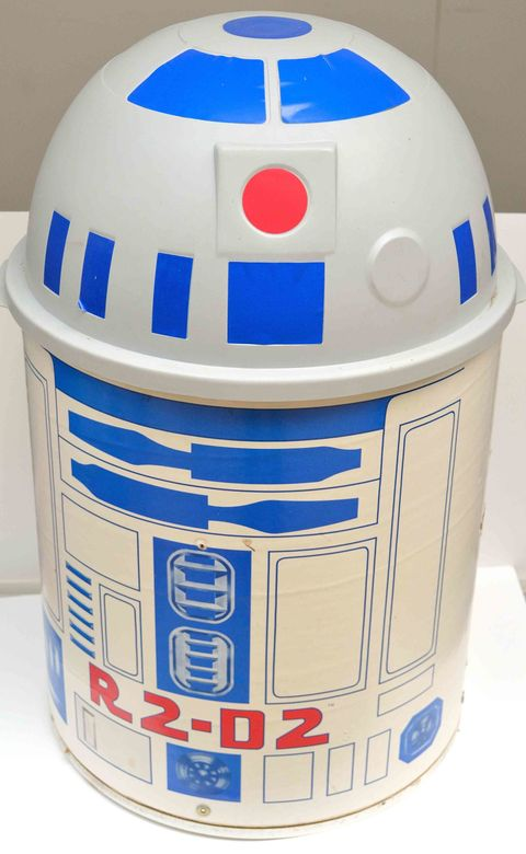 "Released around the time of <em>Return of the Jedi, </em>the <a target=""_blank"" href=""http://theswca.com/images-toys/r2-toytoter.html"">R2-D2 Toy Toter</a> is a collector's item today. The lid lifted up to reveal toy storage inside. Out of the box, they go for more than $200 on eBay. If it's still in the original box? More than $1,400."