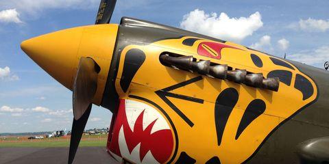 Mode of transport, Airplane, Daytime, Sky, Yellow, Aircraft, Propeller, Aviation, Propeller-driven aircraft, Air travel,