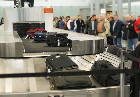 Automotive design, Engineering, Machine, Employment, Luggage and bags, Baggage, Luxury vehicle, Hall, Electronics, Company,