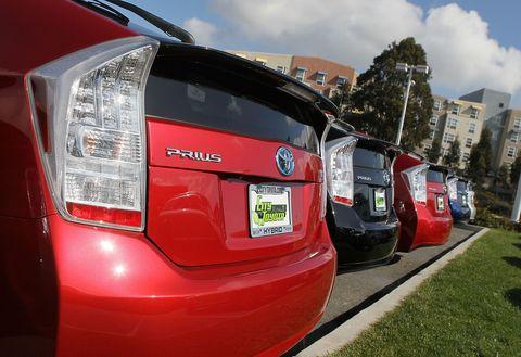 Motor vehicle, Automotive tail & brake light, Automotive design, Automotive exterior, Automotive lighting, Red, Bumper, Vehicle registration plate, Logo, Trunk,