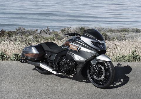 Motorcycle, Automotive design, Automotive tire, Rim, Automotive exterior, Fender, Automotive lighting, Automotive wheel system, Auto part, Carbon,