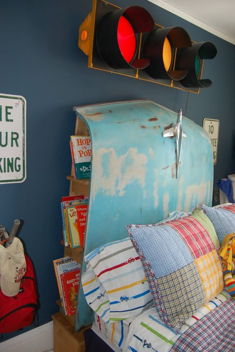 "Look closely—the headboard of this bed is actually an old car hood! Built-in shelves behind the hood offer handy storage space.   Learn more at <a target=""_blank"" href=""http://stamptillucramp.blogspot.com/2010/09/bachmans-fall-idea-house-2010.html"">Stamp till U Cramp</a>."