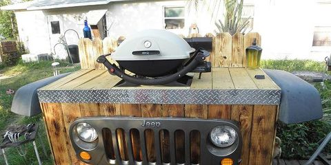 """With leftover Jeep parts added for decoration, this grill stand made from wooden shipping pallets is so much more than ordinary.   Learn more at <a target=""""_blank"""" href=""""http://www.hometalk.com/5466459/upcycle-jeep-parts-into-a-bbq-grill-stand"""">Hometalk</a>."""