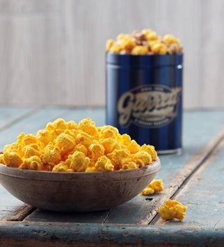 "Exclusively for Father's Day, Garrett takes its famous Cheddar-smothered CheeseCorn and infuses it with smoky, barbecue-inspired flavor. This snack is a perfect nosh on a lazy summer Sunday and (bonus!) you can pick from a variety of tin designs. (<em>$31-$135, <a target=""_blank"" href=""http://www.garrettpopcorn.com/"">garrettpopcorn.com</a></em>)