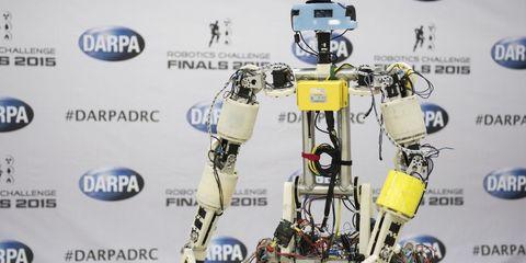 Yellow, Technology, Machine, Logo, World, Robot, Fictional character, Mecha, Figurine, Toy,