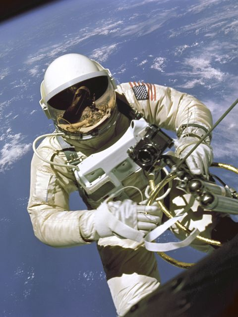 UNITED STATES - NOVEMBER 05:  On June 3, 1965 Edward H. White II became the first American to step outside his spacecraft and let go, effectively setting himself adrift in the zero gravity of space. For 23 minutes White floated and maneuvered himself around the Gemini spacecraft while logging 6500 miles during his orbital stroll. White was attached to the spacecraft by a 25 foot umbilical line and a 23 foot tether line, both wrapped in gold tape to form one cord. In his right hand White carries a Hand Held Self Maneuvering Unit (HHSMU) which is used to move about the weightless environment of space. The visor of his helmet is gold plated to protect him from the unfiltered rays of the sun.  (Photo by SSPL/Getty Images)