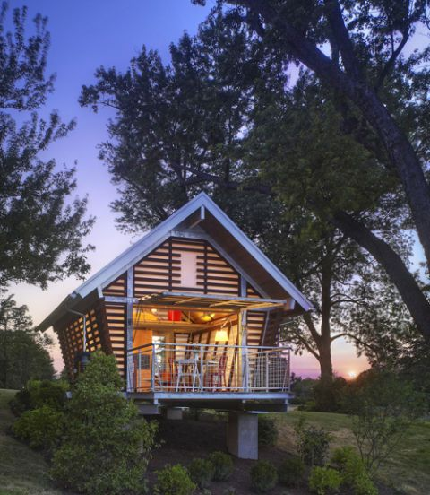 "<p dir=""ltr"">Designed by <a href=""http://www.broadhurstarchitects.com/"">Broadhurst Architects</a>, this prefab <a href=""http://www.thecrib.info/"">corn crib-inspired structure</a> takes its basic form from traditional American corn cribs, which were common farm buildings that served to store and dry corn. The chic, modern <a href=""http://www.broadhurstarchitects.com/residentialarchitecture/architecture_04.html"">250-square-foot</a> structure is delivered and assembled on-site, and includes a sleeping loft, an expandable kitchen wall, a bathroom, and living room. An insulated glass garage door opens to a small deck, connecting the interior space to the landscape beyond. Made of sustainable and recyclable materials, the structure can be dismantled and relocated to another site. <em>—ESN</em></p> <p dir=""ltr""><a href=""http://www.broadhurstarchitects.com/residentialarchitecture/architecture_04.html"">Look inside the Crib at Strathmore</a>.</p>"
