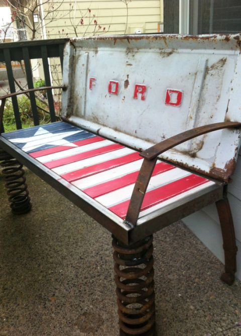 "A product of the combined efforts of an interior designer and a mechanic, this one-of-a-kind bench is made from an old tailgate, coils, and leaf springs.   Learn more at <a target=""_blank"" href=""https://www.etsy.com/listing/108714223/rusty-old-car-parts-patriotic-bench"">Double Star Design</a>."