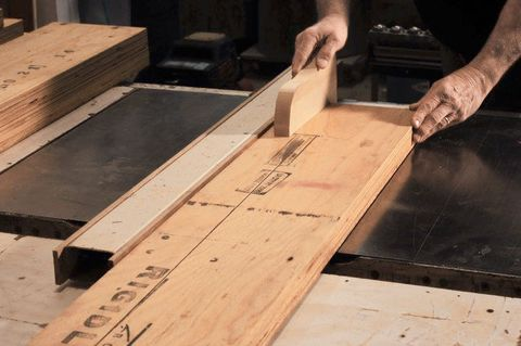 Set the saw fence to 3 1⁄8 inches and make the first ripping pass. Be sure to use a push stick as you near the end of the cut. Make one rip pass on each of the six pieces of LVL. Use a woodworking square and a straightedge to check the ripped edge for square and flatness.