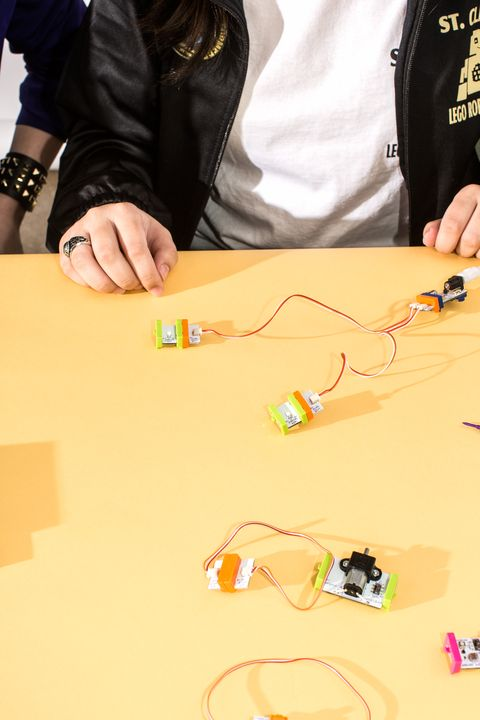 Build a circuit by connecting parts in this order—battery and cable, power, split—and then attach one bright LED to each terminus of the split.