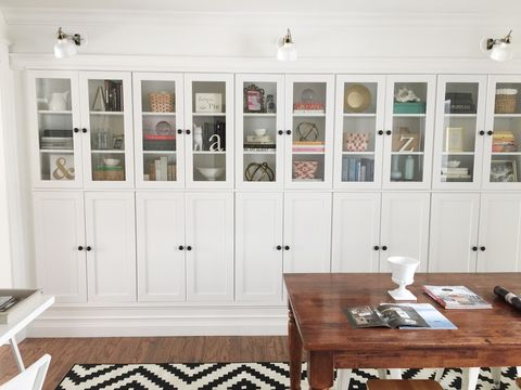 "<p>Lining a wall, a row of these cabinets seriously impresses. This blogger used glass doors on top and solid doors on the bottom, so there's space above for pretty things and plenty of hiding spots below.</p> <p><a target=""_blank"" href=""http://www.averystreetdesign.com/2014/12/office-reveal-part-1.html"">See more at Avery Street Design »</a></p>"
