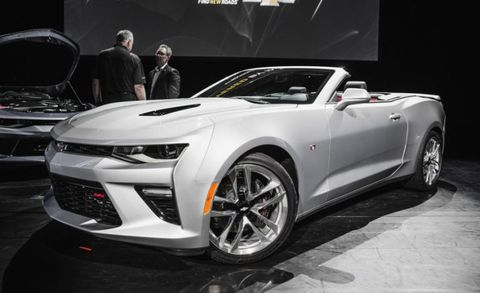 It's pleasing to see, too. The new Camaro is already a looker, but the convertible is a particularly slick piece with the top down, thanks to its rigid, body-color tonneau cover that extends the decklid's creases toward the rear seats.