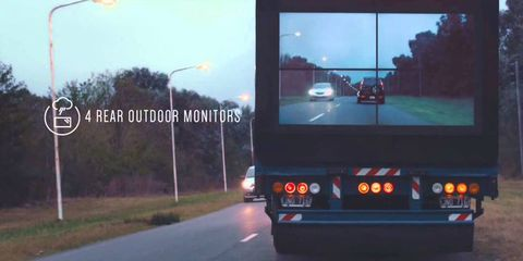 Motor vehicle, Mode of transport, Automotive design, Road, Infrastructure, Automotive lighting, Automotive mirror, Street light, Glass, Asphalt,
