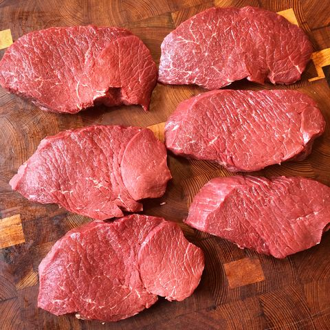 A really good, inexpensive cut that Mayer takes off of the top round. Salt the cut for about 45 minutes before you grill—this allows time for the salt to absorb, which adds flavor and tenderizes the meat, too. Then pat dry and cook low and slow. Pro tip: save the liquid (a mix of water and a protein called myoglobin) that leaches out after salting and the juices that pour off the cut when it's resting on the grill. Throw them in a pot, add a little balsamic and butter, then reduce the combination. Slice the meat and pour the jus on top.