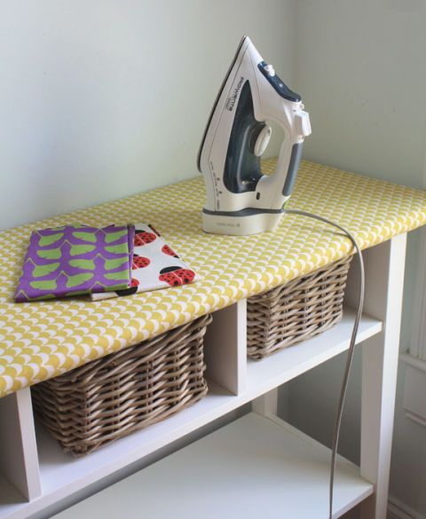 "A traditional ironing board eats up valuable room with it's X-like frame (and who actually folds it up after <em>every</em> use?). This clever IKEA hack turns the top of a long table into an ironing space, and offers spots for baskets underneath.  <a href=""http://thelongthread.com/?p=11117=""><em>See more at The Long Thread »</em></a>"
