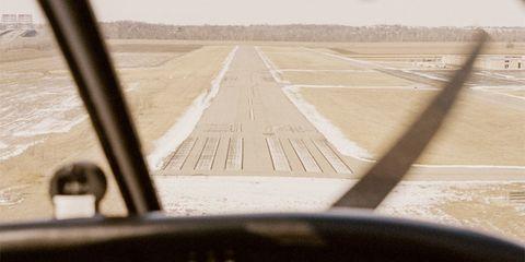 Runway, Infrastructure, Atmosphere, Plain, Horizon, Line, Land lot, Atmospheric phenomenon, Air travel, Aircraft,