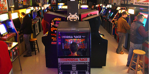 Recreation, Electronic device, Machine, Games, Arcade game, Technology, Display device, Gamer, Indoor games and sports, Video game arcade cabinet,