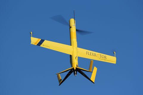 Airplane, Yellow, Aircraft, Flight, Atmosphere, Air travel, Aviation, General aviation, Propeller-driven aircraft, Light aircraft,
