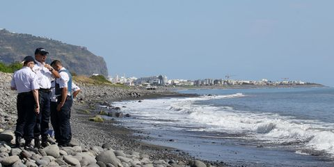 Body of water, Coastal and oceanic landforms, Coast, Shore, Hat, Tourism, Beach, Rock, Ocean, Bank,