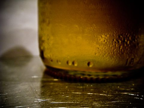 Liquid, Fluid, Yellow, Drinkware, Drink, Alcohol, Alcoholic beverage, Tableware, Oil, Liqueur,