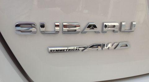 Motor vehicle, Automotive exterior, Logo, Symbol, Emblem, Trademark, Brand, Silver, City car,
