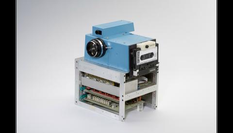 Product, Electronic device, Technology, Camera, Lens, Cameras & optics, Film camera, Machine, Electronics, Teal,