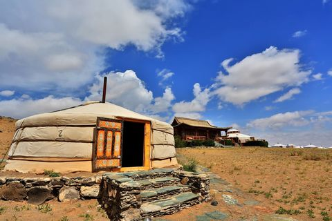 """<p><strong>Location:</strong> Gobi Desert, Mongolia</p><p><strong>The experience:</strong> An off-the-beaten path adventure where rugged living is the norm. The ecolodge, modeled after traditional Buddhist temple architecture, offers stellar views of the ancient Bulagtai Mountain and tours on camelback. </p><p><strong>Don't miss: </strong>A diverse and<strong> </strong>spectacular array of wildlife, including the elusive snow leopard. </p><p><strong>Learn more:</strong> <a href=""""http://www.threecamellodge.com/about-us/history-awards/"""" target=""""_blank"""">Three Camel Lodge</a></p>"""